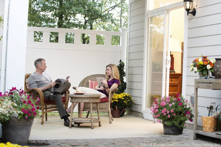 Couple sitting in patio home courtyard
