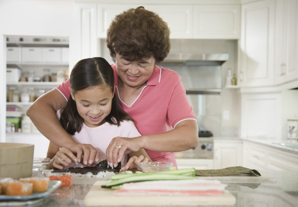 Lifestyle_Stock_Grandmother_Granddaughter_Cooking_39637389