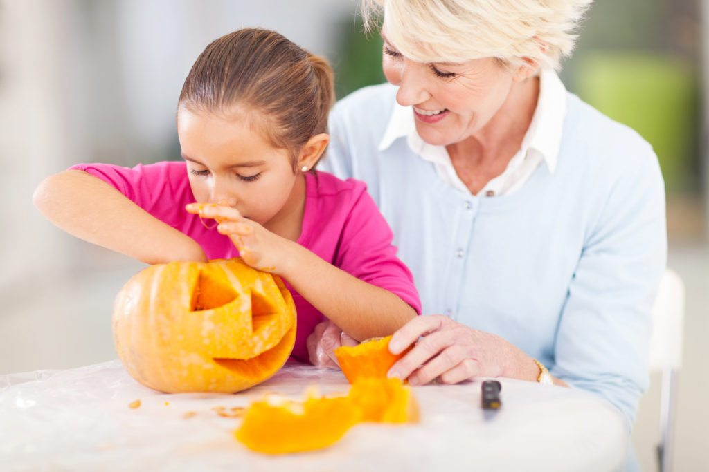 Lifestyle_Stock_Grandmother_Granddaughter_Pumpkin_56897141