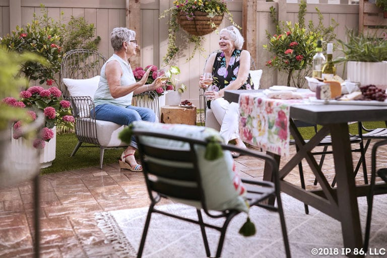 Two women sitting on patio