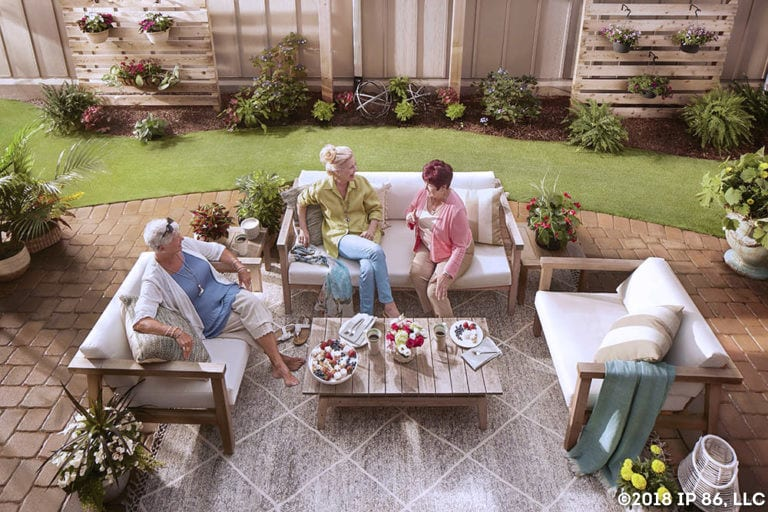 People sitting on patio furniture in Epcon courtyard