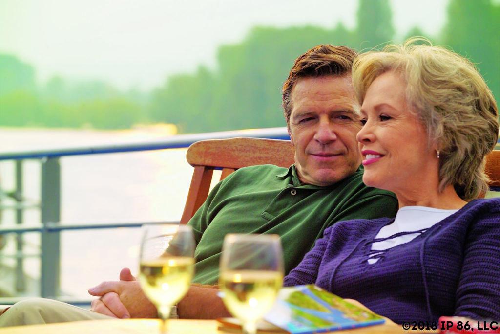 Man and woman enjoying wine on the sun deck